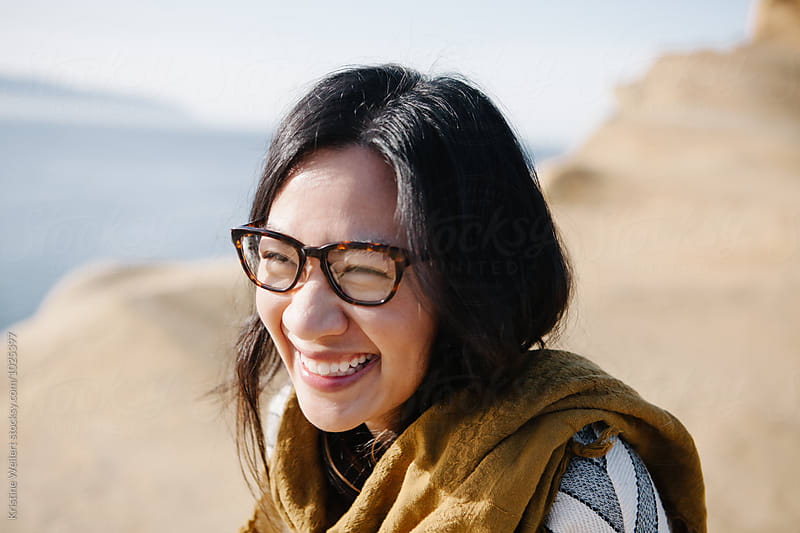 Laughing  woman wearing glasses by Kristine Weilert for Stocksy United