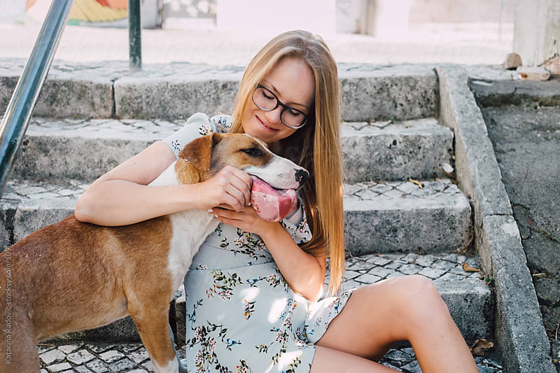 Young Woman Playing With Her Dog by Katarina Radovic for Stocksy United