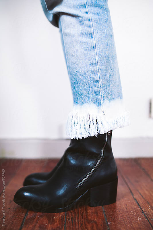 Woman wearing denim and boots by Treasures & Travels for Stocksy United