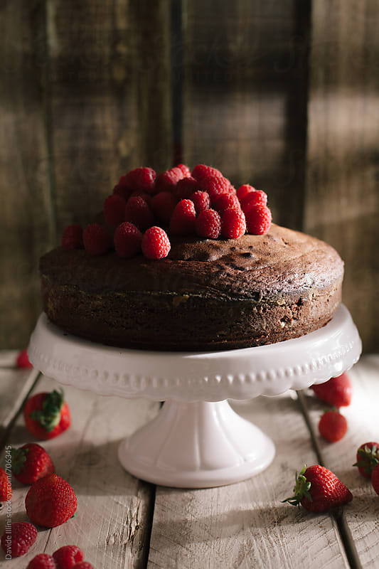 Chocolate cake with fresh raspberries by Davide Illini for Stocksy United