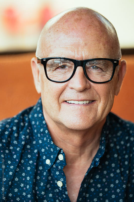 Senior stylish man portrait wearing glasses by Inuk Studio for Stocksy United