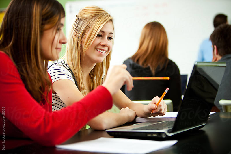 High School: Two Girls Use Laptop in Class by Sean Locke for Stocksy United