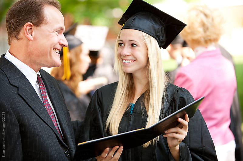 Graduation: Girl and Father Check Out New Diploma by Sean Locke for Stocksy United
