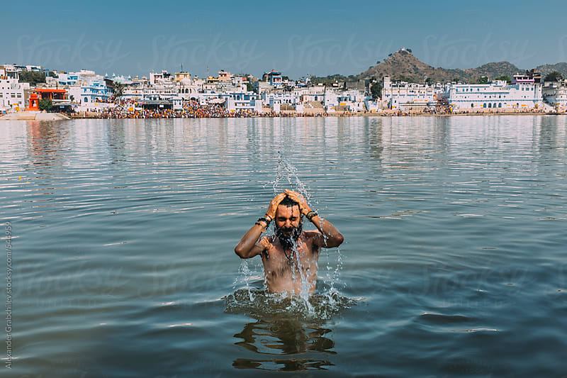 Indian Ritual Ablutions at Holy Lake by Alexander Grabchilev for Stocksy United