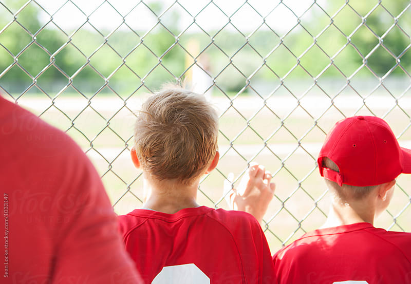 Baseball: Kids Standing At Fence Waiting To Bat by Sean Locke for Stocksy United