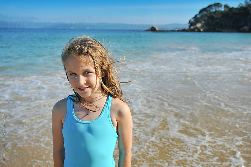 girl at the beach by Gillian Vann for Stocksy United