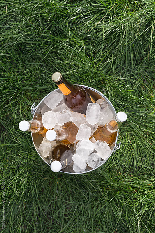 Cold refreshing beer in an ice bucket by RG&B Images for Stocksy United