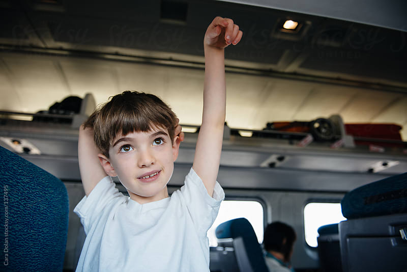 Child travels by train by Cara Dolan for Stocksy United
