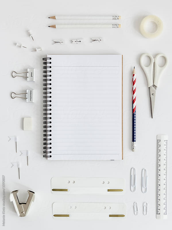 Stars and Stripes pencil among white office supplies by Melanie Kintz for Stocksy United