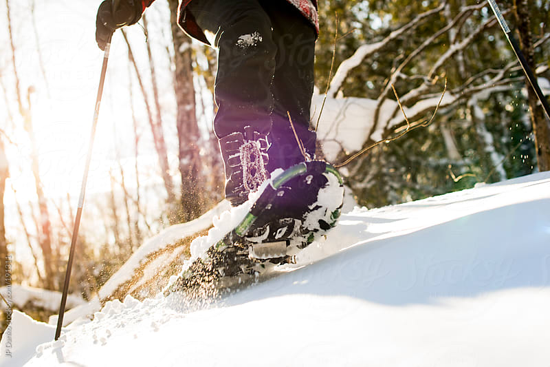 Man Snowshoeing In Winter Snow In Forest by JP Danko for Stocksy United