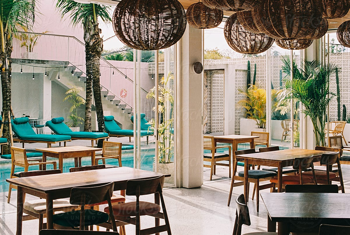 Tropical Interior Design   Restaurant Tables And Chairs In Styli By  VISUALSPECTRUM For Stocksy United