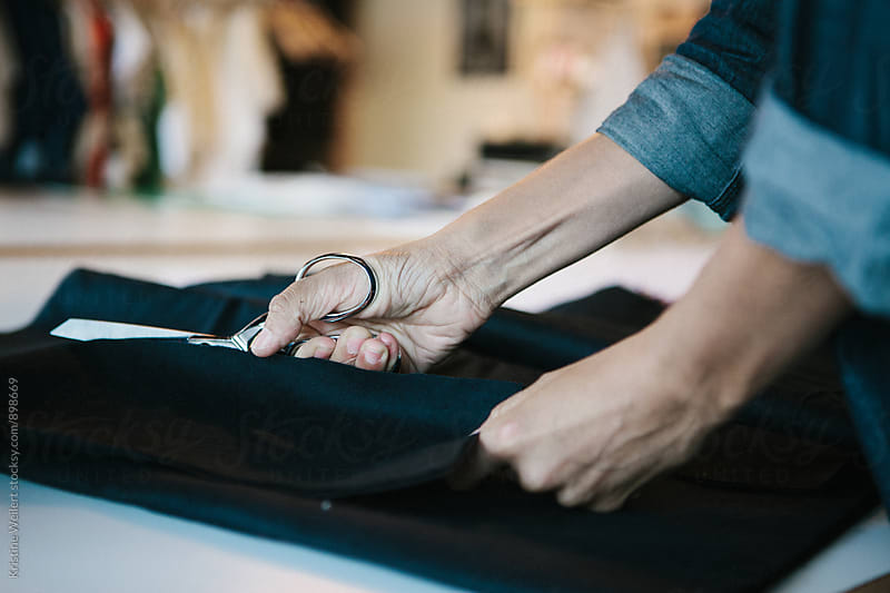 Womans Hands Cutting Fabric by Kristine Weilert for Stocksy United