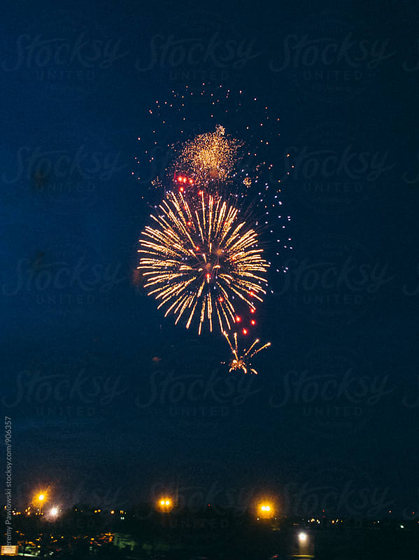 Bright fireworks over small town USA by Jeremy Pawlowski for Stocksy United