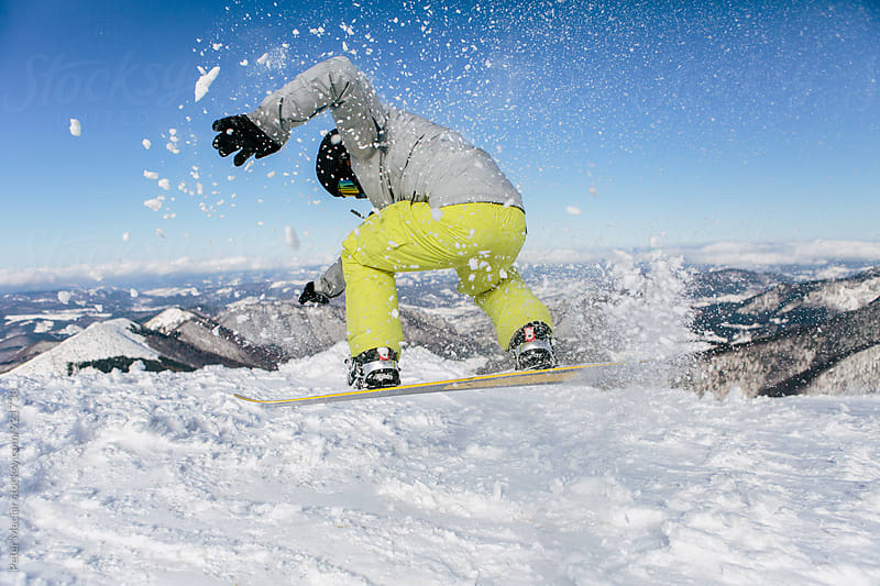 snowboarder ride down the hill by Peter Meciar for Stocksy United