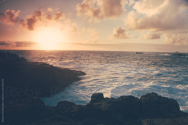 Sunset over the sea in lands end, england by Robert Kohlhuber for Stocksy United