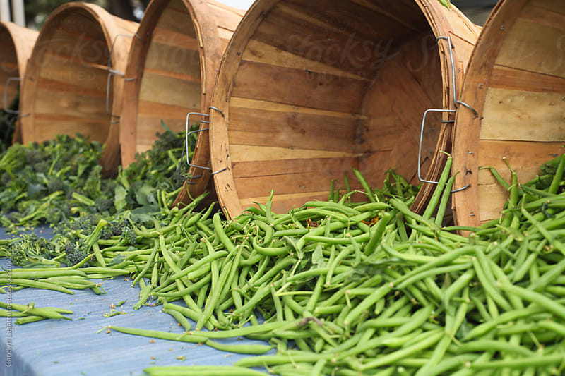 Buckets of green beans and broccoli at the Farmer's Market by Carolyn Lagattuta for Stocksy United