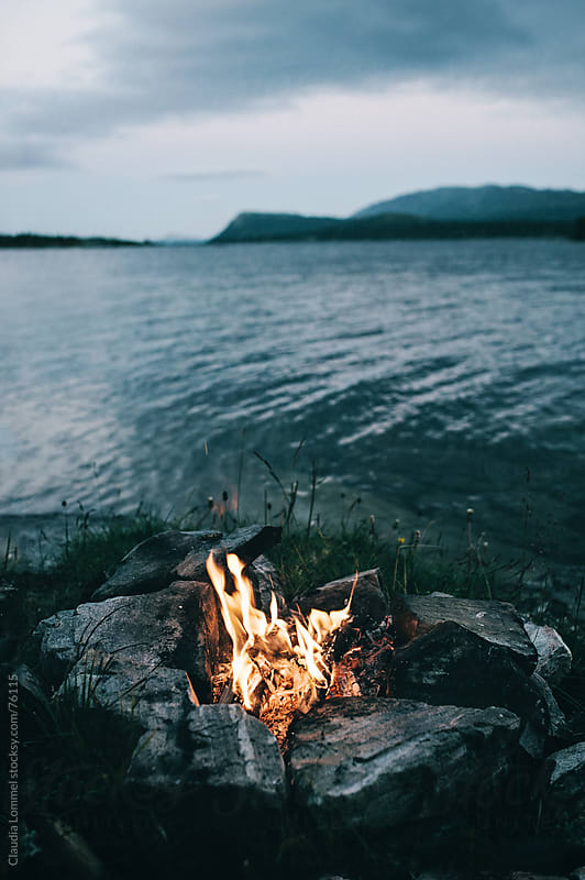 Campfire at a Lakeshore by Claudia Lommel for Stocksy United