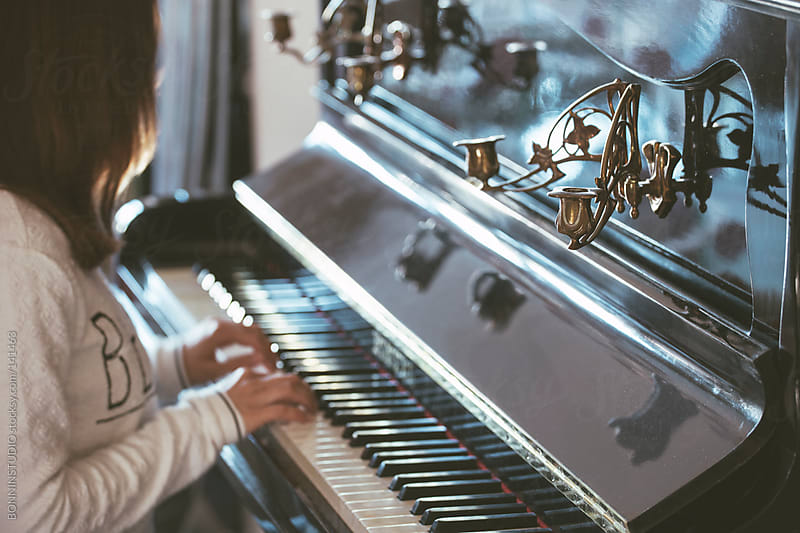 Closeup of woman playing the antique piano. by BONNINSTUDIO for Stocksy United