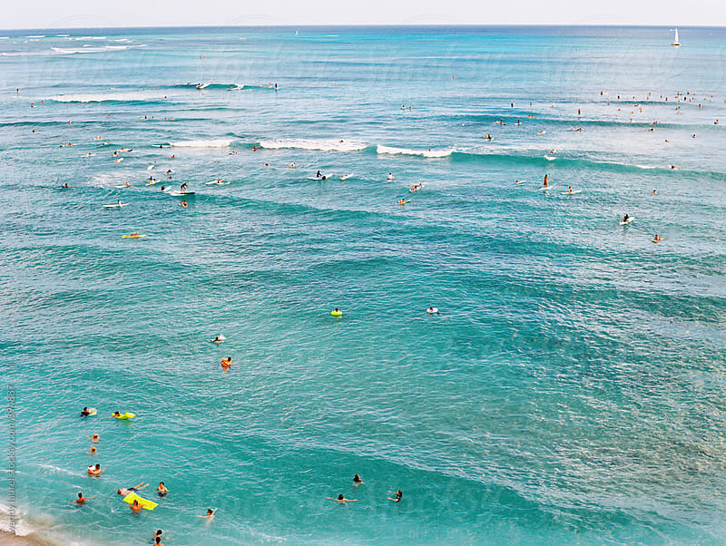 ocean scene in waikiki during summer in hawaii with surfers swimmers by wendy laurel for Stocksy United