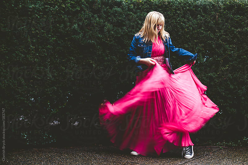 Woman in a pink gown runs free. by Cherish Bryck for Stocksy United