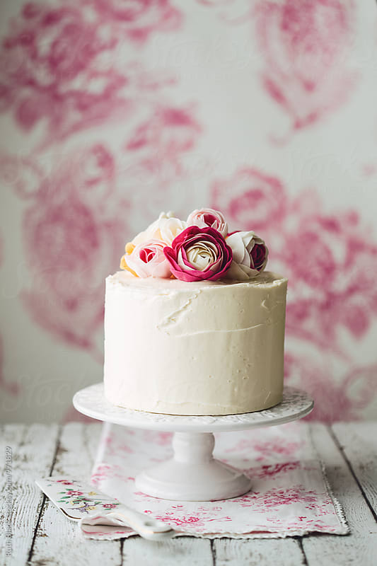 Vintage style cake with roses by Ruth Black for Stocksy United