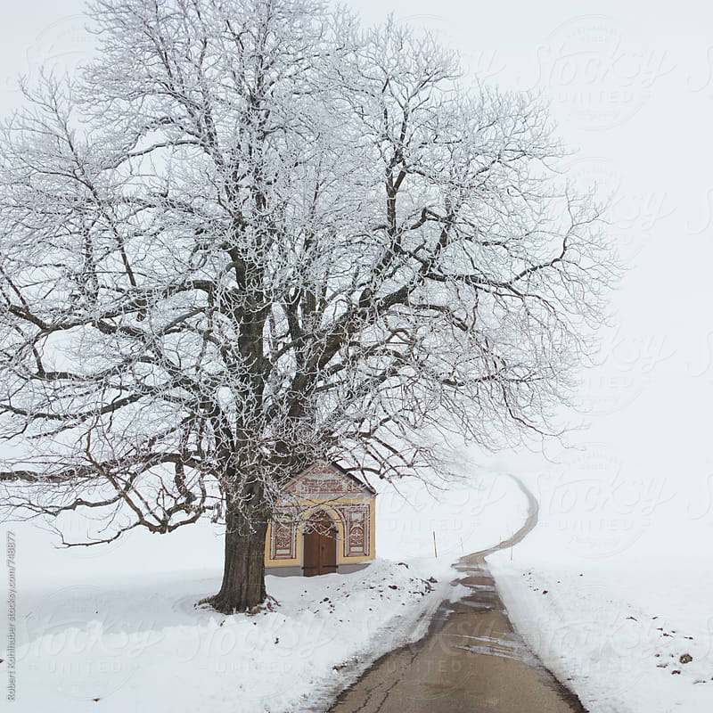 Winter road with chapel in austria by Robert Kohlhuber for Stocksy United