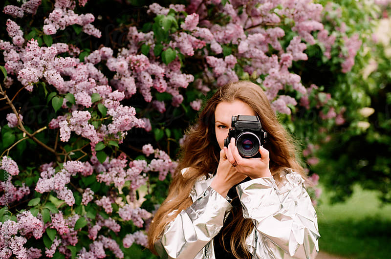 Woman taking photo with old analog camera by Liubov Burakova for Stocksy United