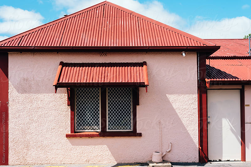old stone building with corrugated tin roof in Australia by Gillian Vann for Stocksy United