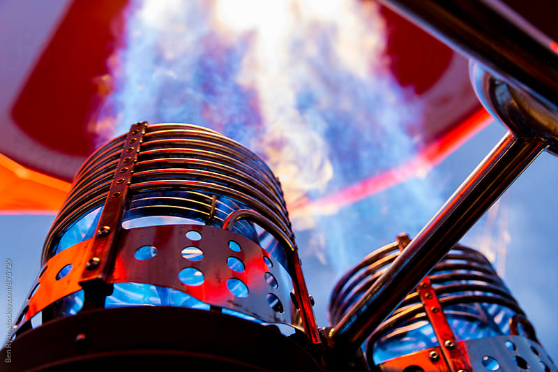 Blue and orange flame blasting from two gas burners in hot air balloon by Ben Ryan for Stocksy United