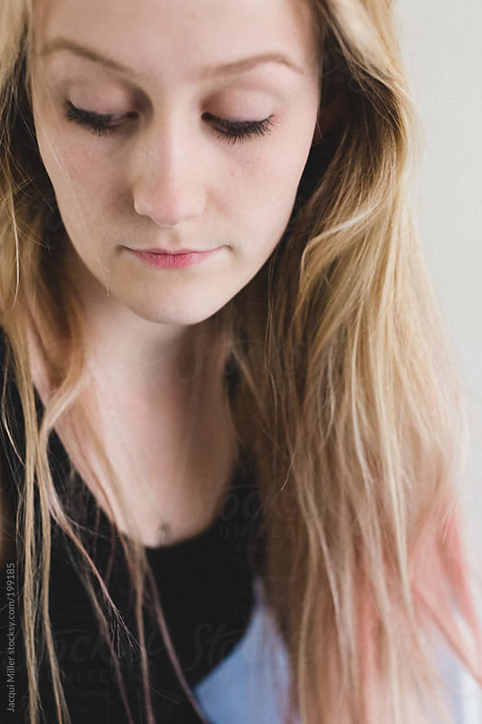 Close up portrait of a pretty young woman with long blonde hair.  by Jacqui Miller for Stocksy United