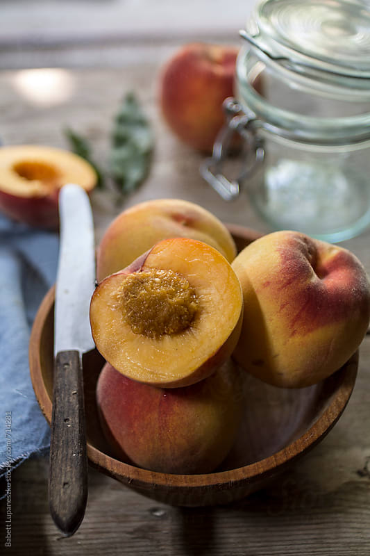 Fresh peaches by Babett Lupaneszku for Stocksy United