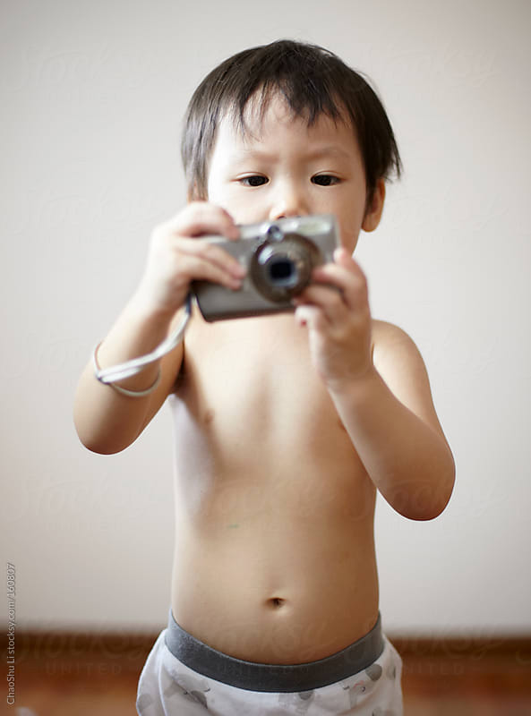 Asian cute little girl holding a camera  by ChaoShu Li for Stocksy United