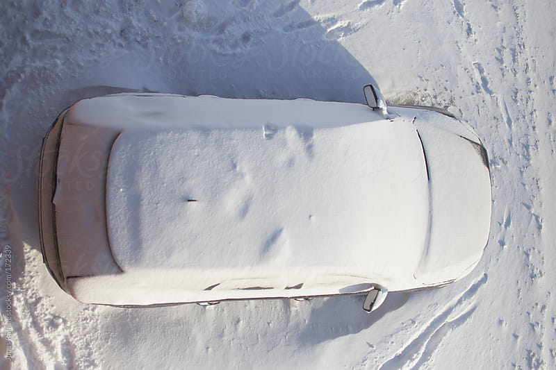 Car covered in snow by Jonas Räfling for Stocksy United