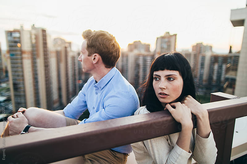 Young couple spend time on the rooftop by Evgenij Yulkin for Stocksy United