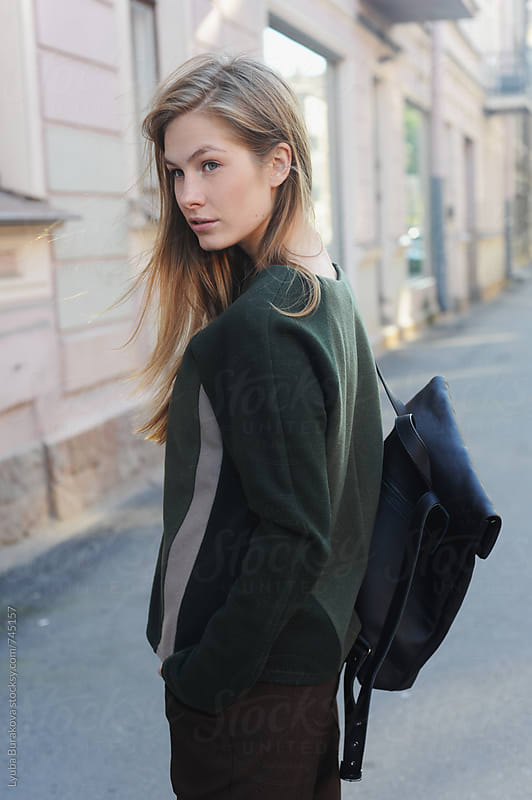 Young woman with a backpack by Lyuba Burakova for Stocksy United