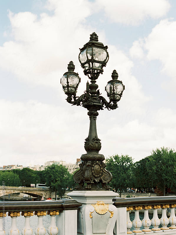 Lamps on a bridge in Paris by Kirstin Mckee for Stocksy United