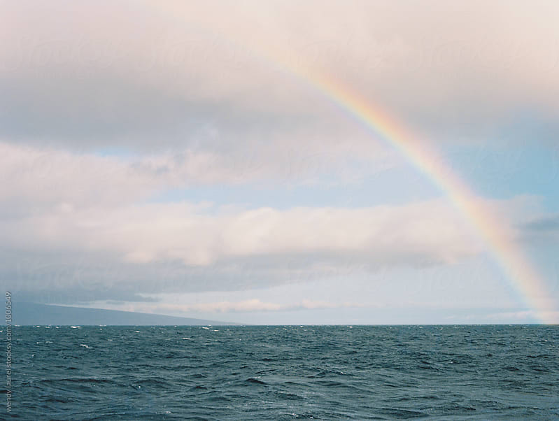 rainbow over ocean in hawaii by wendy laurel for Stocksy United