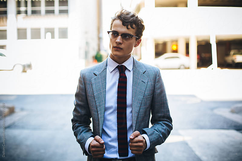 Young Man in a vintage suit traveling around city by Dalton Campbell for Stocksy United