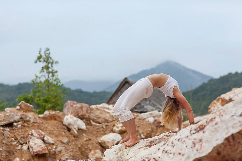Woman Practising Yoga in Nature by Mosuno for Stocksy United
