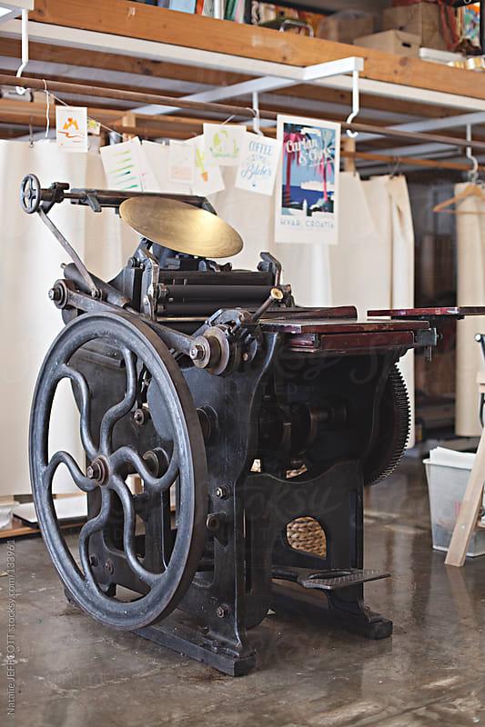 vintage letterpress machine by Natalie JEFFCOTT for Stocksy United