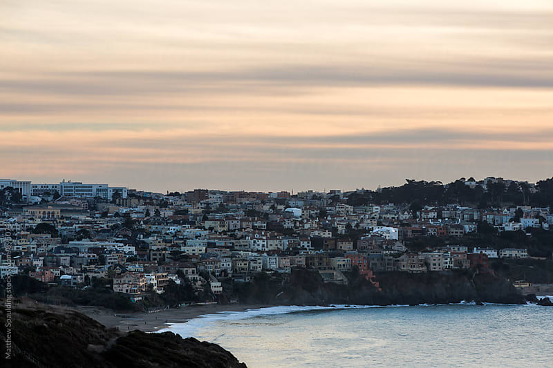 San Francisco area homes on seaside hills in evening by Matthew Spaulding for Stocksy United