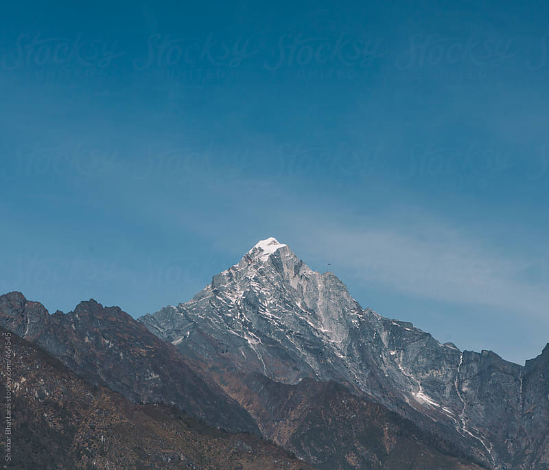 Receding snow in mountains. by Shikhar Bhattarai for Stocksy United