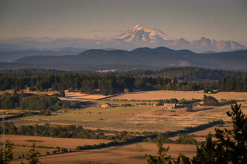 Mt Baker seen from San Juan Island at sunset by Mick Follari for Stocksy United