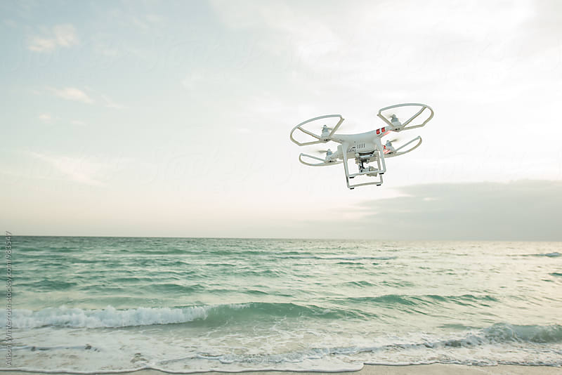 A Drone Hovers On The Beach In Florida by Alison Winterroth for Stocksy United