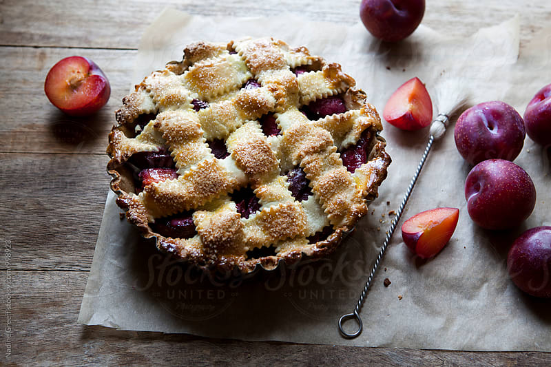 Sweet plum pie by Nadine Greeff for Stocksy United