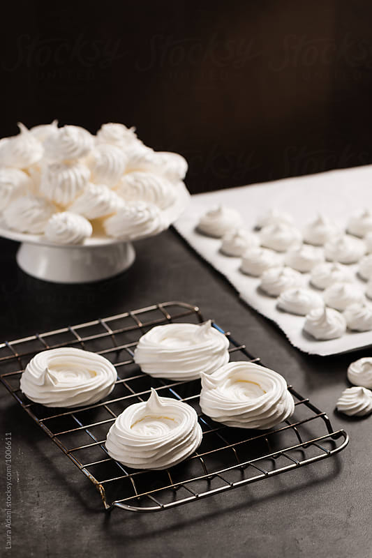 Mini pavlova on a rack by Laura Adani for Stocksy United
