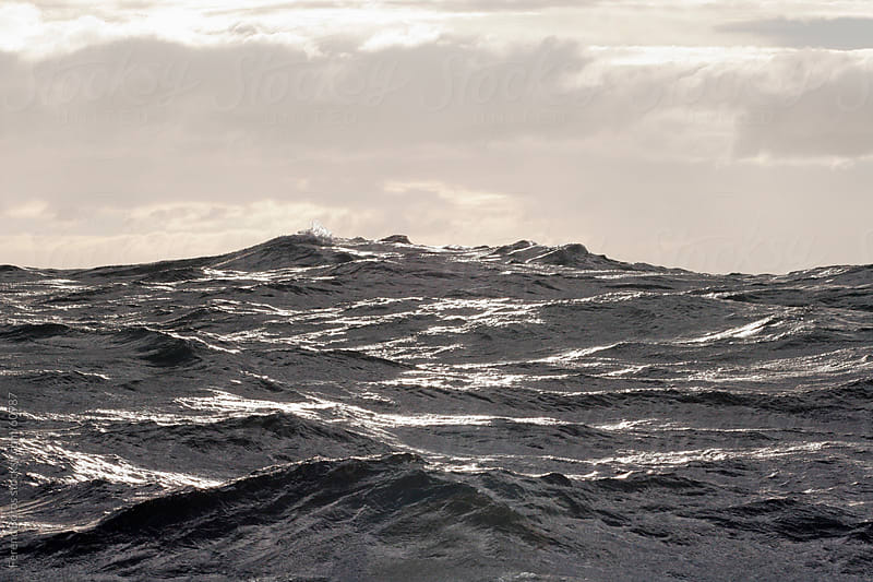 Clouds above the glittering waves by Ferenc Boros for Stocksy United