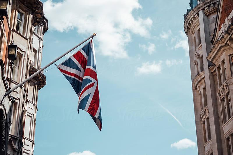 London Street With England Flag Swinging  by Katarina Radovic for Stocksy United