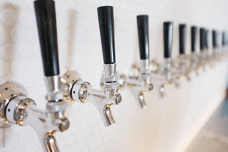 freshly poured beer at modern cafe pub by Jesse Morrow for Stocksy United