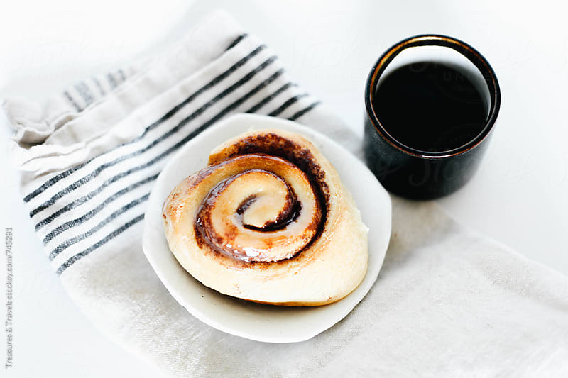 cinnamon bun and coffee on white background by Treasures & Travels for Stocksy United